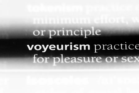 voyeurism word in a dictionary. voyeurism concept.