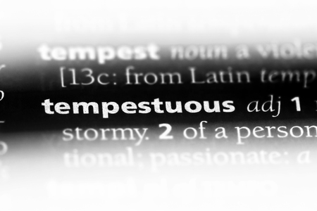 tempestuous word in a dictionary. tempestuous concept. Фото со стока