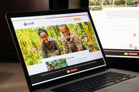 Milan, Italy - August 15, 2018: Send a Cow Uganda NGO website homepage. Send a Cow Uganda logo visible. Editorial
