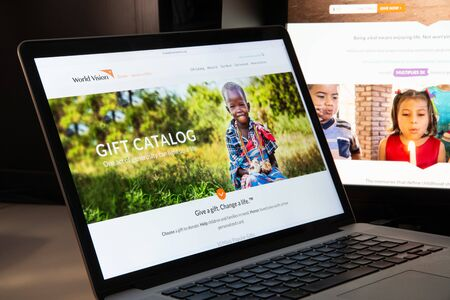 Milan, Italy - August 15, 2018: World Vision NGO website homepage. World Vision logo visible.