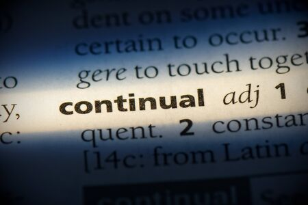 continual word in a dictionary. continual concept, definition. Stock Photo