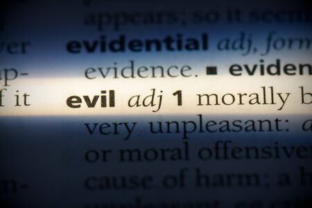 evil word in a dictionary. evil concept, definition.