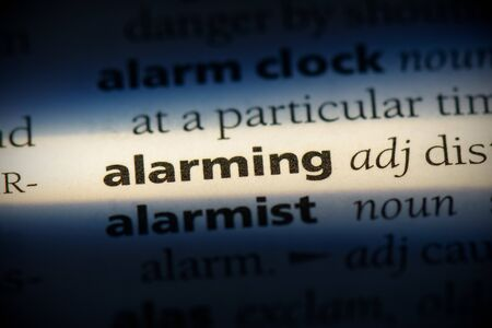 alarming word in a dictionary. alarming concept, definition.