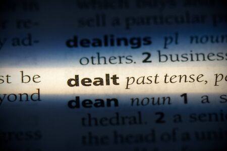 dealt word in a dictionary. dealt concept, definition. Stock Photo