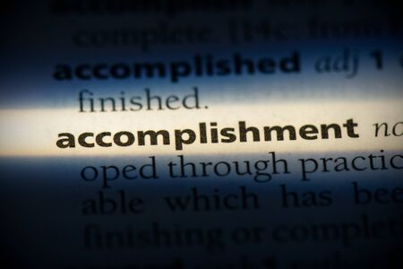 accomplishment word in a dictionary. accomplishment concept, definition. 版權商用圖片