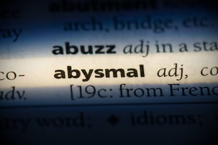 abysmal word in a dictionary. abysmal concept, definition. Stock Photo