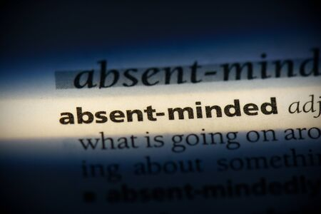 absent-minded word in a dictionary. absent-minded concept, definition. Stock Photo