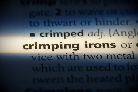 crimping irons word in a dictionary. crimping irons concept, definition. 写真素材 - 132116561