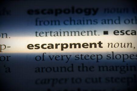 escarpment word in a dictionary. escarpment concept, definition. 写真素材 - 132116564