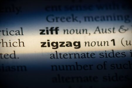 zigzag word in a dictionary. zigzag concept, definition. Stok Fotoğraf