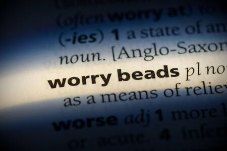 worry beads word in a dictionary. worry beads concept, definition.