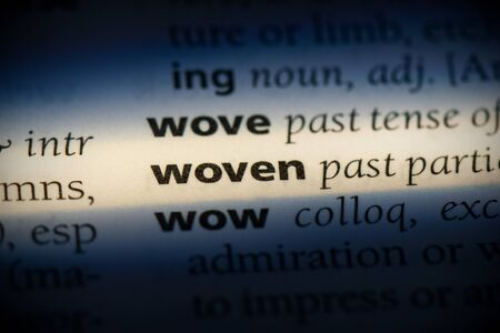 woven word in a dictionary. woven concept, definition. Stok Fotoğraf