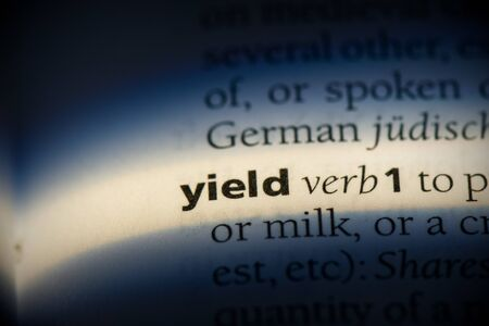 yield word in a dictionary. yield concept, definition. 写真素材 - 132117773