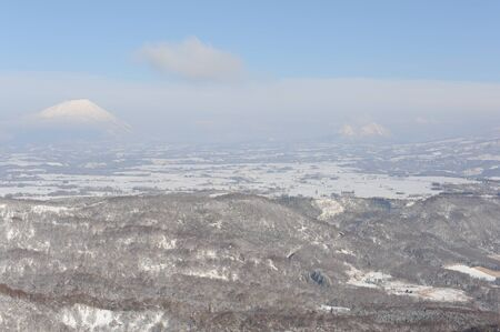 White winter landscape with a snow-covered volcano photo