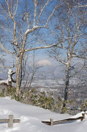 snowcovered: White winter landscape with a snow-covered volcano