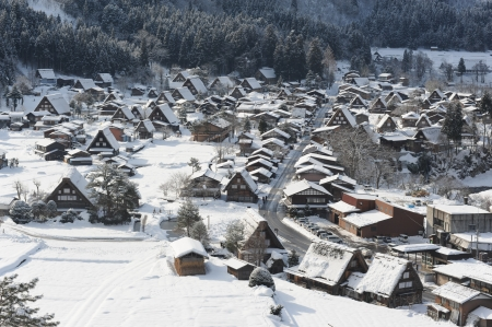 Thatched roof houses on a snowy winter day photo