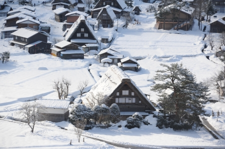 Thatched roof houses on a snowy winter day