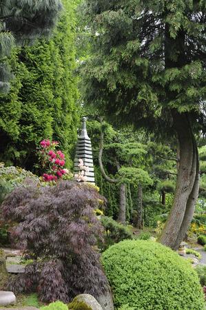 Japanese garden with stone pagoda Stock Photo