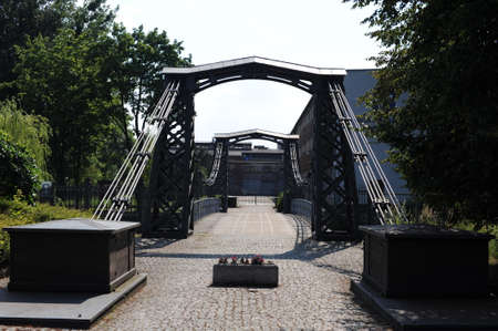 THE OLDEST SURVIVING IRON SUSPENSION CHAIN BRIDGE IN EUROPE ON THE MAŁA PANEW RIVER IN THE CITY OF OZIMEK IN SOUTHERN POLAND WITH a chain structure suspended on openwork cast iron pylons Standard-Bild