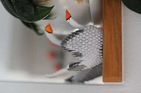 3D modular origami paper swan handmade with white paper - an example of craftwork and handwork requiring craftsmanship