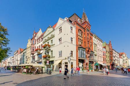 Torun, Kuyavian province, Poland - September 14, 2016: Tenements on Old Town Marketplace and Szeroka Street.