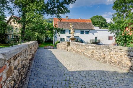 Ladek Zdroj, Lower Silesia province, Poland - July 17, 2016: Ghotic bridge of Saint John of Nepomuk.