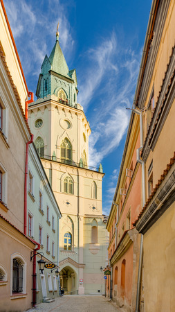 Lublin, Lublin province, Poland - July 8, 2017. Bystreet leading to Trinitarian Tower (17th-19th century), seat of the archdiocesan museum.