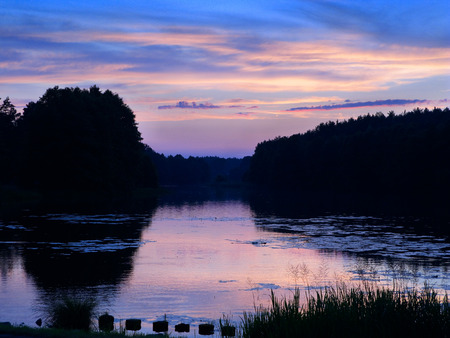 Sunset over Mylof lake.  Tuchola Pinewoods, Pomeranian province,Poland, Europe.