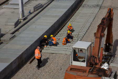 Construction and renovation of a railway station in Krakow. Group of workers.