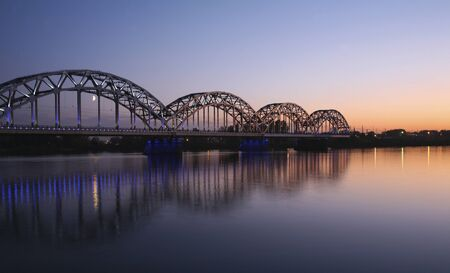 ruffling: bridge over the river at evening Stock Photo