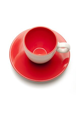 cup and saucer on white background photo