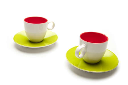 cups and colors on white background photo