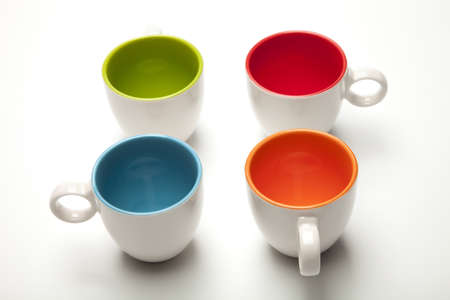 cups and colors on white background Stock Photo - 12983346