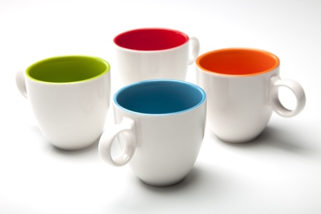 cups and colors on white background