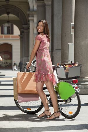 woman goes shopping with bicycle Stock Photo - 13235008