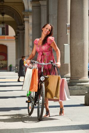 woman goes shopping with bicycle photo