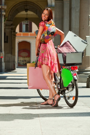 woman goes shopping with bicycle Stock Photo - 13235003
