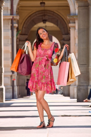 woman goes shopping with lots of bags Stock Photo - 13235010