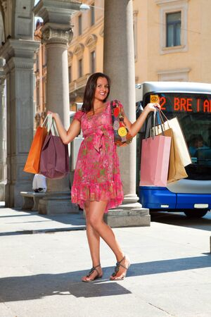 woman goes shopping with lots of bags Stock Photo - 13235006