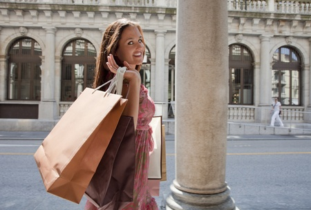woman goes shopping with lots of bags Stock Photo - 13235009