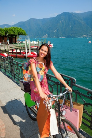 woman goes shopping with bicycle Stock Photo - 13235004