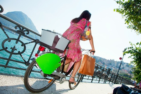 woman goes shopping with bicycle Stock Photo - 13235005