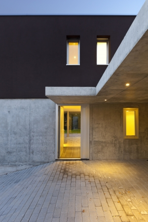 on ramp: view of the beautiful modern house by night, entry