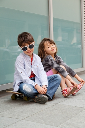 Portrait of a girl and a boy outdoors Stock Photo - 13889085