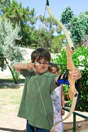 concentration camp: child and archery Stock Photo