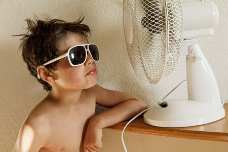 cool: child and ventilator and sunglasses Stock Photo
