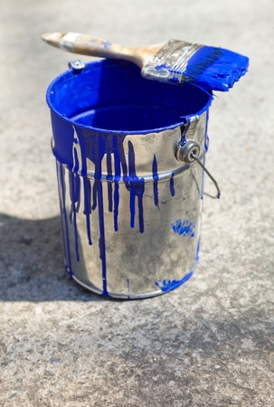 bucket and paint to paint the walls of the house photo