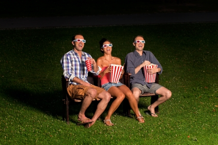 three friends in exterior cinema Stock Photo - 14996132
