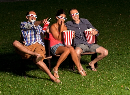 three friends in exterior cinema Stock Photo - 14996130