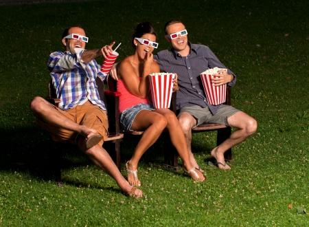three friends in exterior cinema Stock Photo - 14996130